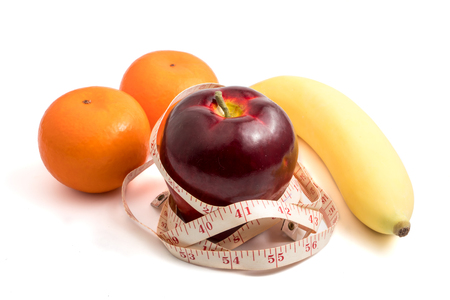 Fresh fruits and measure tape on white background. Healthy lifestyle diet concept
