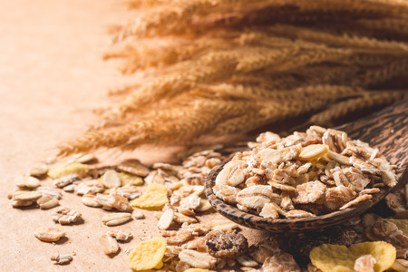 Close up of Oatmeal flakes on wooden table. Healthy breakfast concept. Imagens