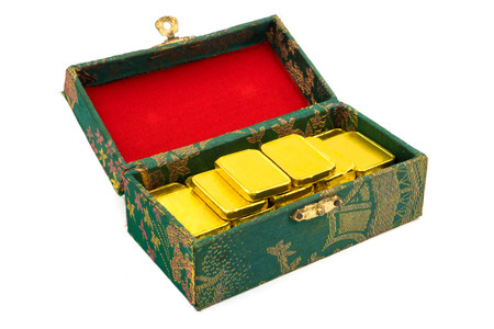 Pure gold bars in green box on white background.