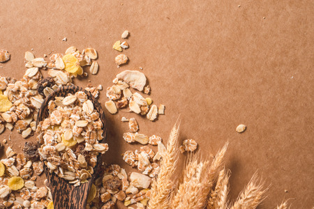 Top view of Oatmeal flakes on wooden table. Healthy breakfast concept. copy space