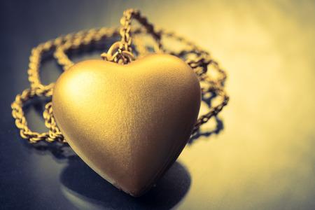 Close up of Gold heart pendant with necklace Reklamní fotografie - 99640455
