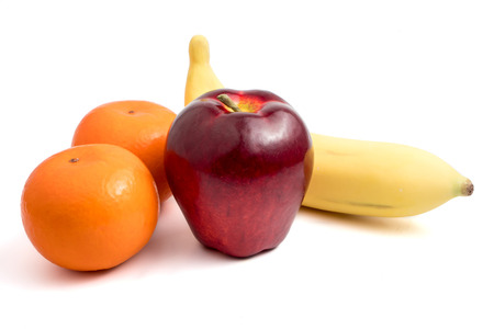 Fresh fruits with apple, banana and oranges on white background.