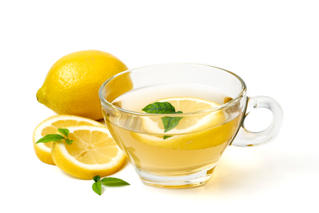 A cup of tea and lemon on a white background