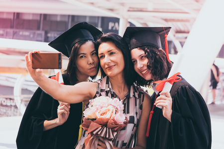 Beautiful woman congratulates for her family on graduation day, Successful concept Stock Photo