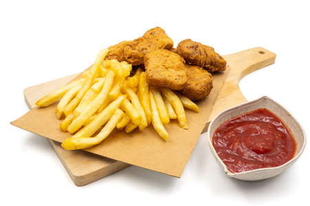 French fries with nuggets and ketchup on a white background.