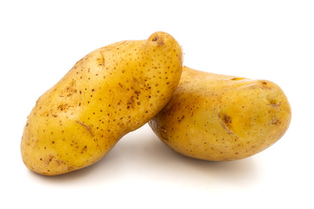 Raw potatoes on a white background