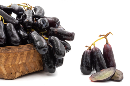 Black seedless moon drops grape or Witch fingers grape in basket on white background Archivio Fotografico - 101591894