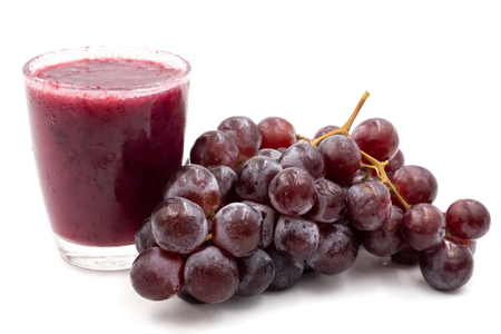 Glass of grape juice smoothie isolated on white background Stock Photo