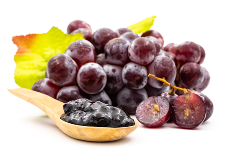 Red grapes and jam on a white background Banco de Imagens