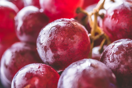 Background of Red grapes with water drops