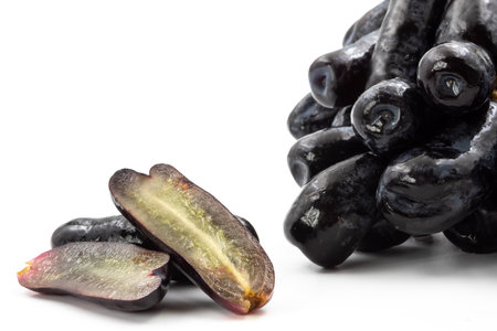 Black seedless moon drops grape or Witch fingers grape on white background