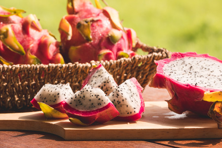 Fresh dragon fruit on wooden table Stock Photo - 103331990