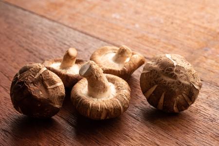 Shiitake mushroom on wooden table 스톡 콘텐츠