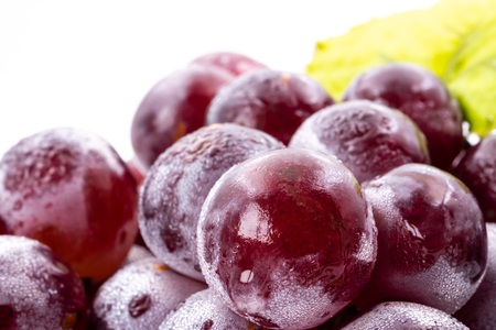 Close up of Red grapes on a white background
