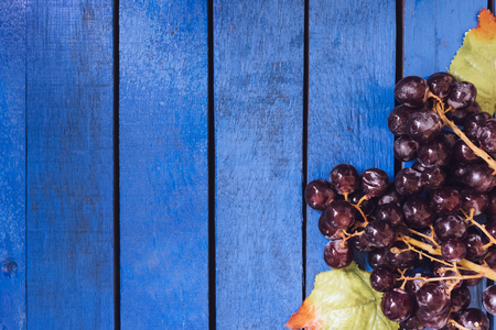 Top view of red grapes on blue wooden table. copy space Stock Photo