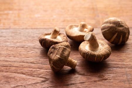 Shiitake mushroom on wooden table Stock Photo