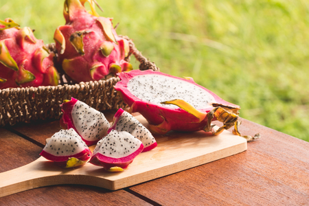 Fresh dragon fruit on wooden table Stock Photo - 104306638