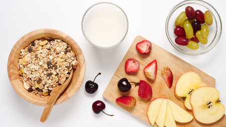 Top view of Oatmeal flakes, milk, and fresh fruits on white background. Stok Fotoğraf