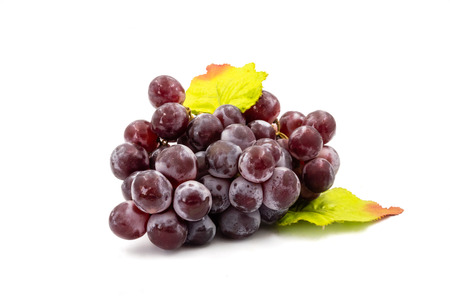 Red grapes on a white background Stock Photo