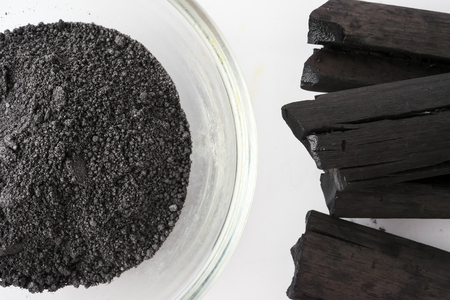 Activated charcoal powder on white background Stock fotó - 104342680