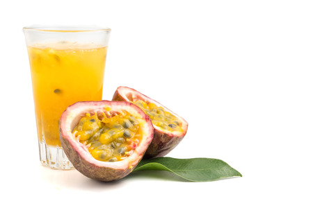 Fresh passion fruit and juice on white background. copy space