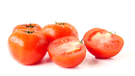 Close up of Fresh tomatoes on white background