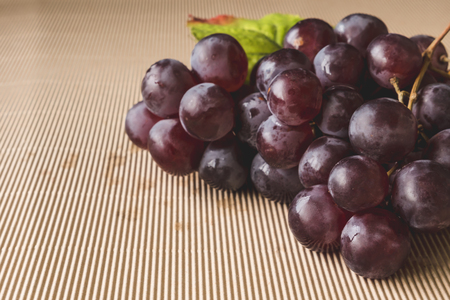 Close up of Red grapes on wooden table