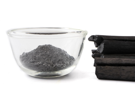 Activated charcoal powder on white background Stock Photo - 104953751