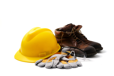 Construction site safety. Personal protective equipment on white background