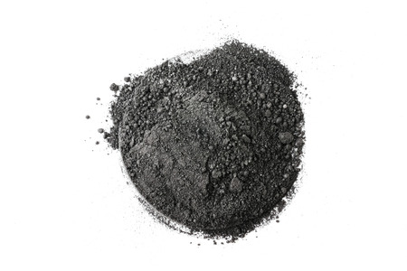 Activated charcoal powder on white background
