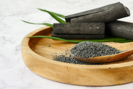 Bamboo charcoal and powder on marble table. Stock Photo - 105364779