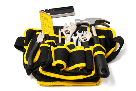 Construction worker belt with tools on white background.