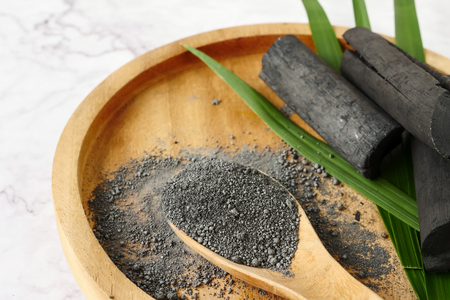 Bamboo charcoal and powder on marble table. Stock Photo - 105487376