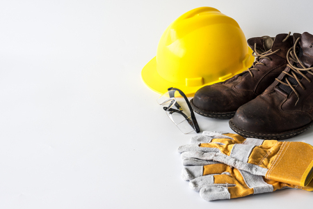 Construction site safety. Personal protective equipment on white background. Free space for text