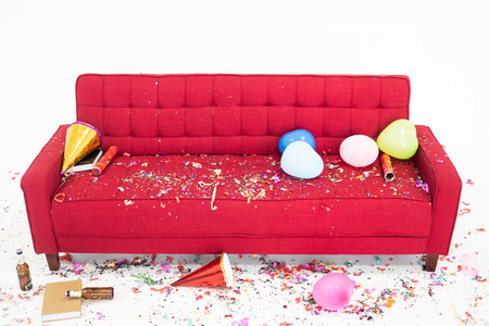 Chaos on the red sofa after new year party Stockfoto - 109206278