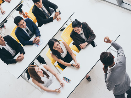 Businessman is explaining works to officers while training together at the office. Stockfoto