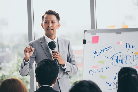 Businessman is explaining works to officers while training together at the office. Stock Photo