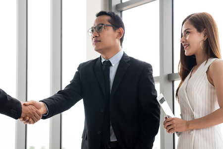 Happy Businesspeople are shaking hands together after finish meeting with successful.