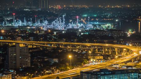 Bangkok city, Thailand, showing traffic on motor way and oil refinery at night Reklamní fotografie
