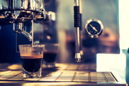 Close up of espresso pouring from coffee machine. Stockfoto
