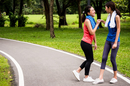 Happy women exercising together in a park