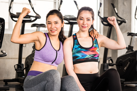 Portrait of attractive young women in sportswear at the gym.