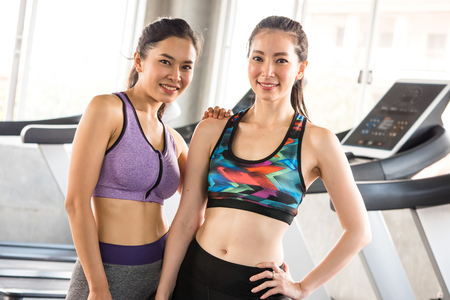 Portrait of attractive young women standing together at the gym.