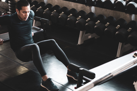 Attractive young man working out at the gym.
