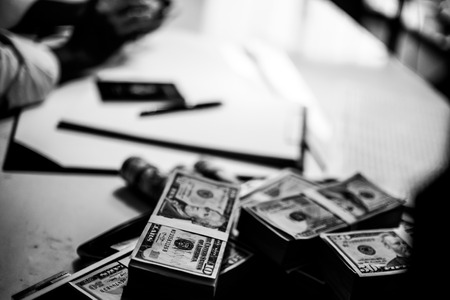 Pile of banknotes and documents on a table. Black and white tone Stockfoto