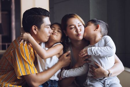 Happy family with kids spending time together at home