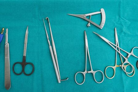 Set of surgical instruments on a blue background. Foto de archivo