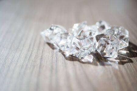 Shiny diamond on wooden