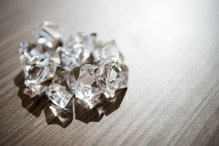 Shiny diamond on wooden