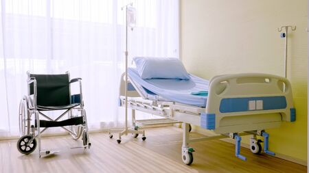 Hospital bed and wheelchair at hospital room.